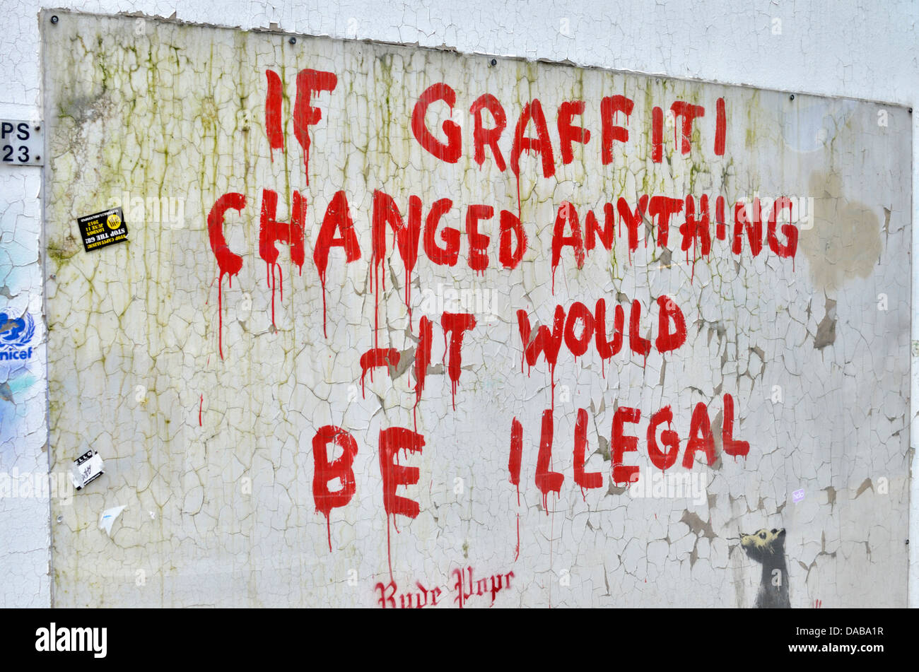 Graffiti on wall reading: ' If graffiti changed anything it would be illegal ' - Stock Image