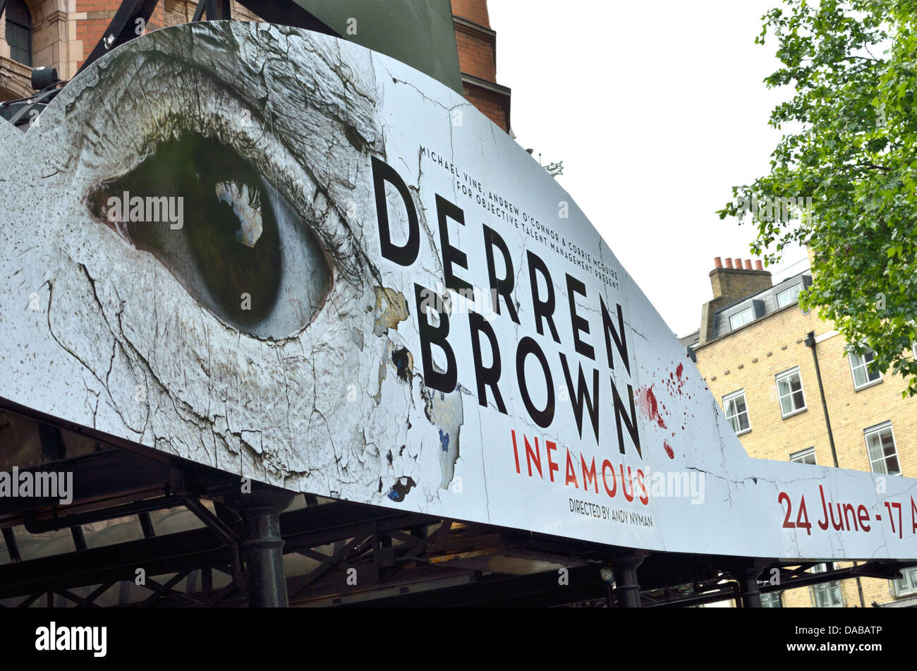 Giant billboard advertising the Derren Brown stage show 'Infamous', Palace Theatre, London, UK - Stock Image