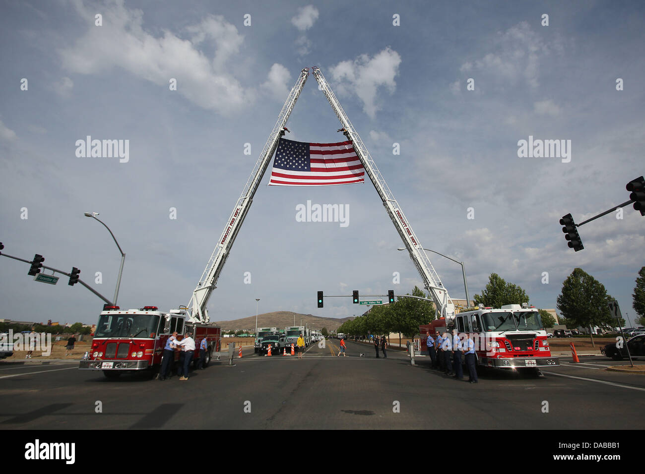 Prescott Valley, AZ, USA. 9th July, 2013. Two fire engines drape an American flag outside of Tim's Toyota Center - Stock Image