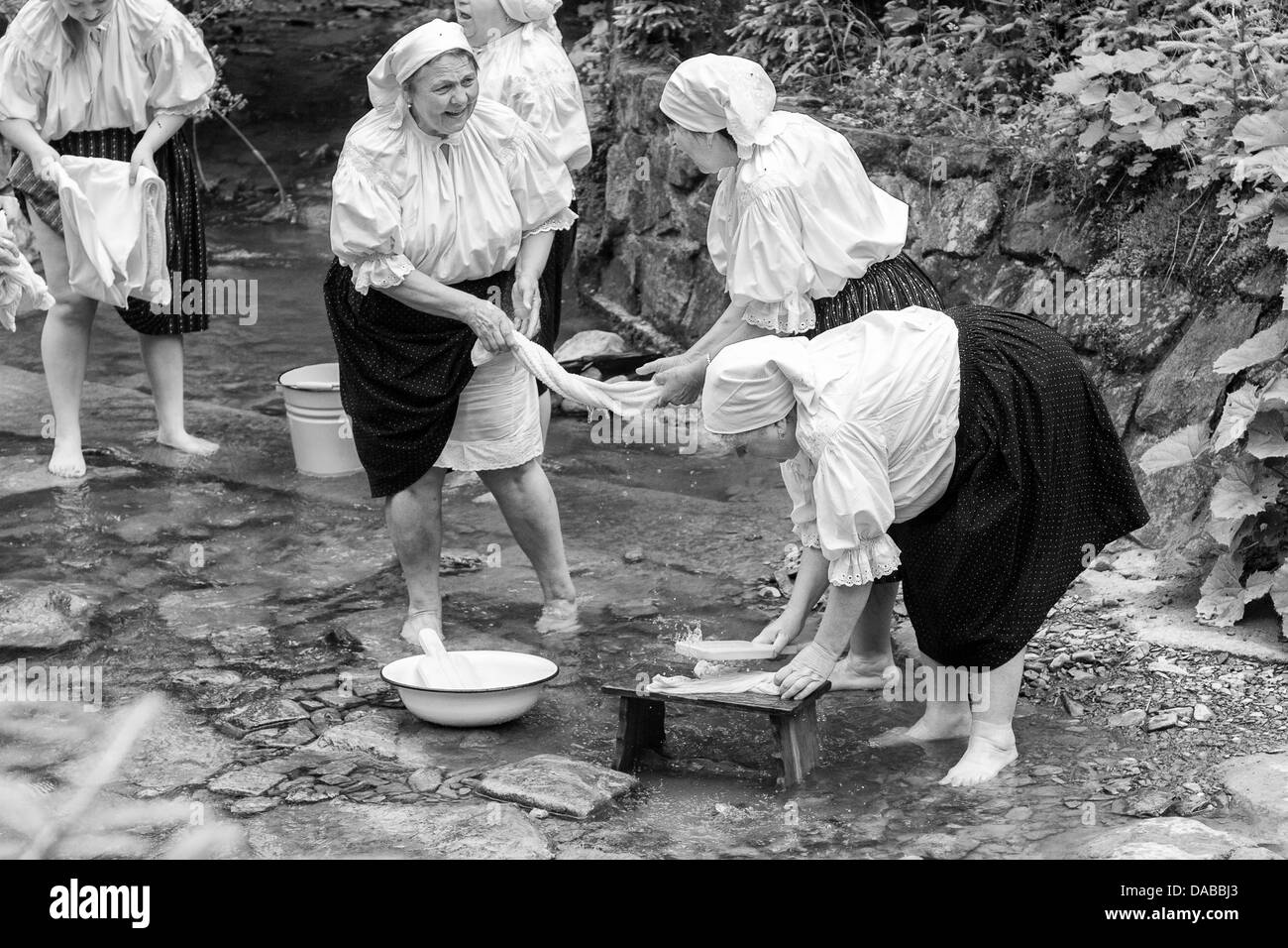 Women hand washing on stream. Show in open-air museum - Stock Image
