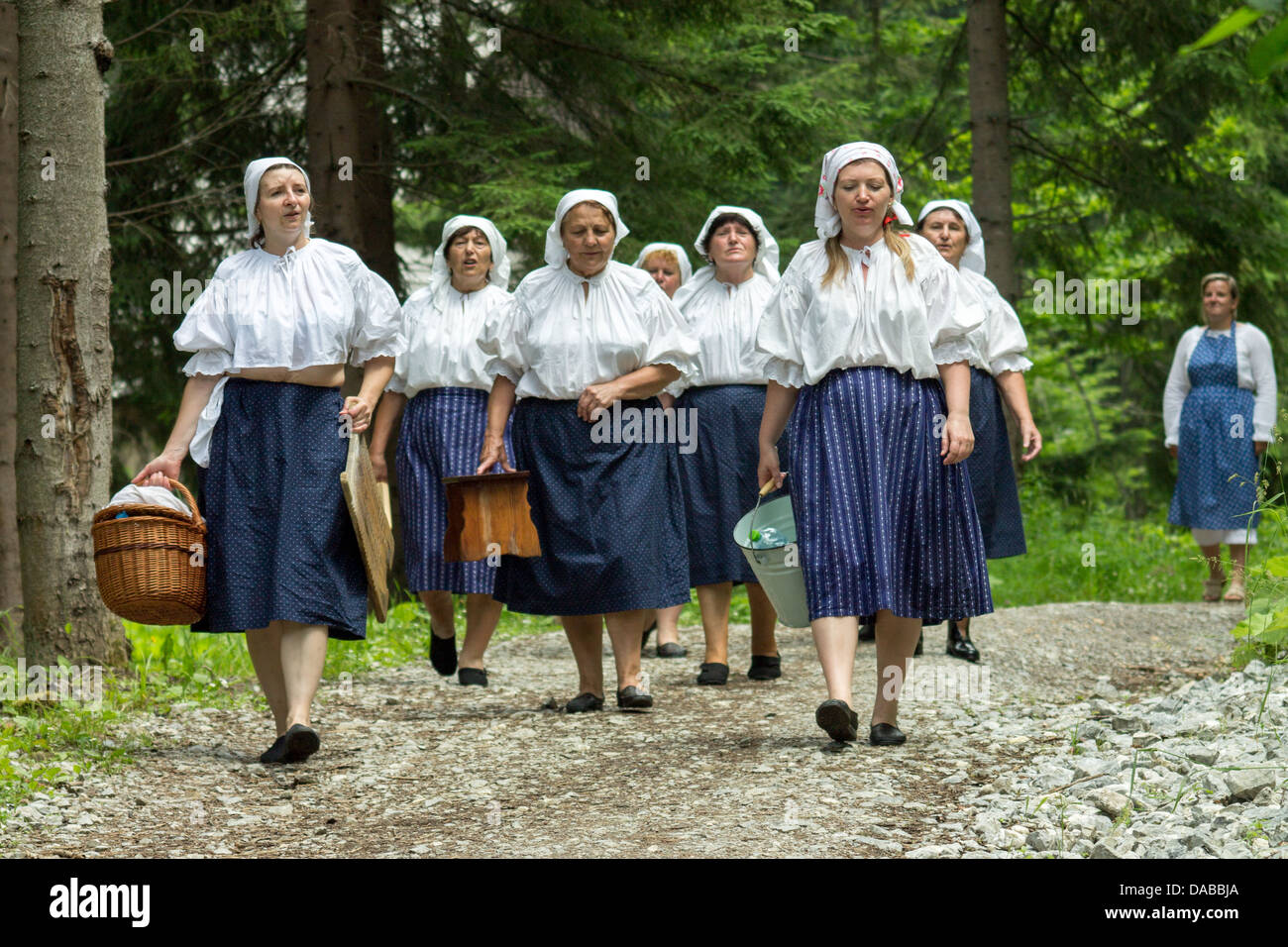 Women go home after finish hand washing on mountain stream Stock Photo