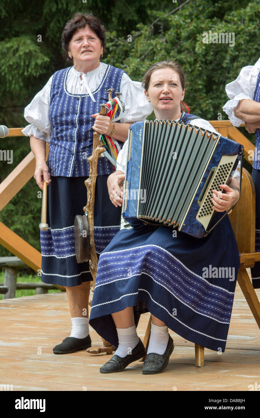 Two musician women in blue skirts - Stock Image
