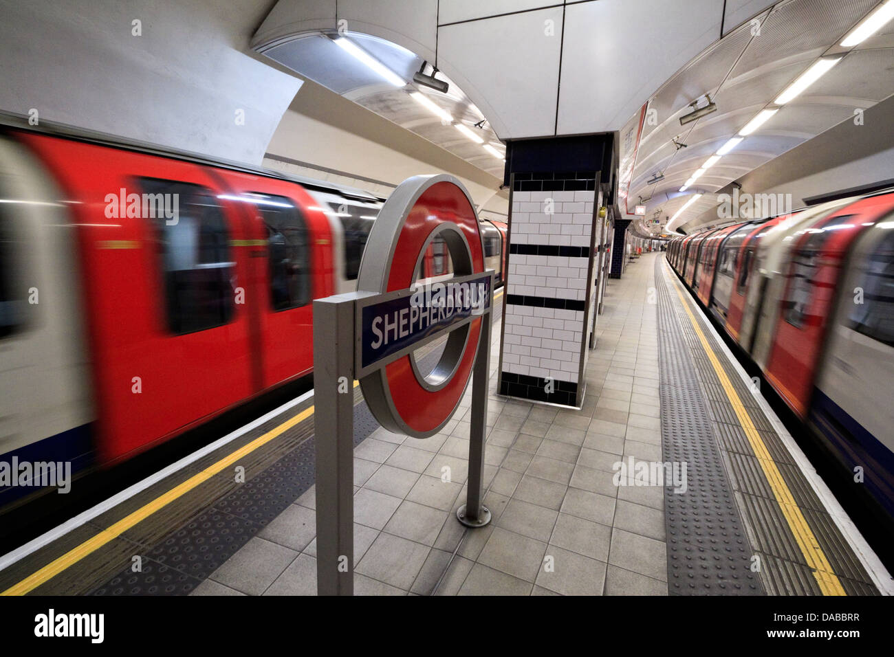 Trains pass at Shepherd's Bush station on the London Underground, London - Stock Image
