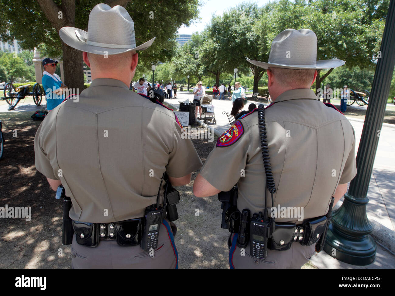Safety officers monitor crowds at the Texas Capitol as politicians consider  new laws restricting abortions an women Stock Photo