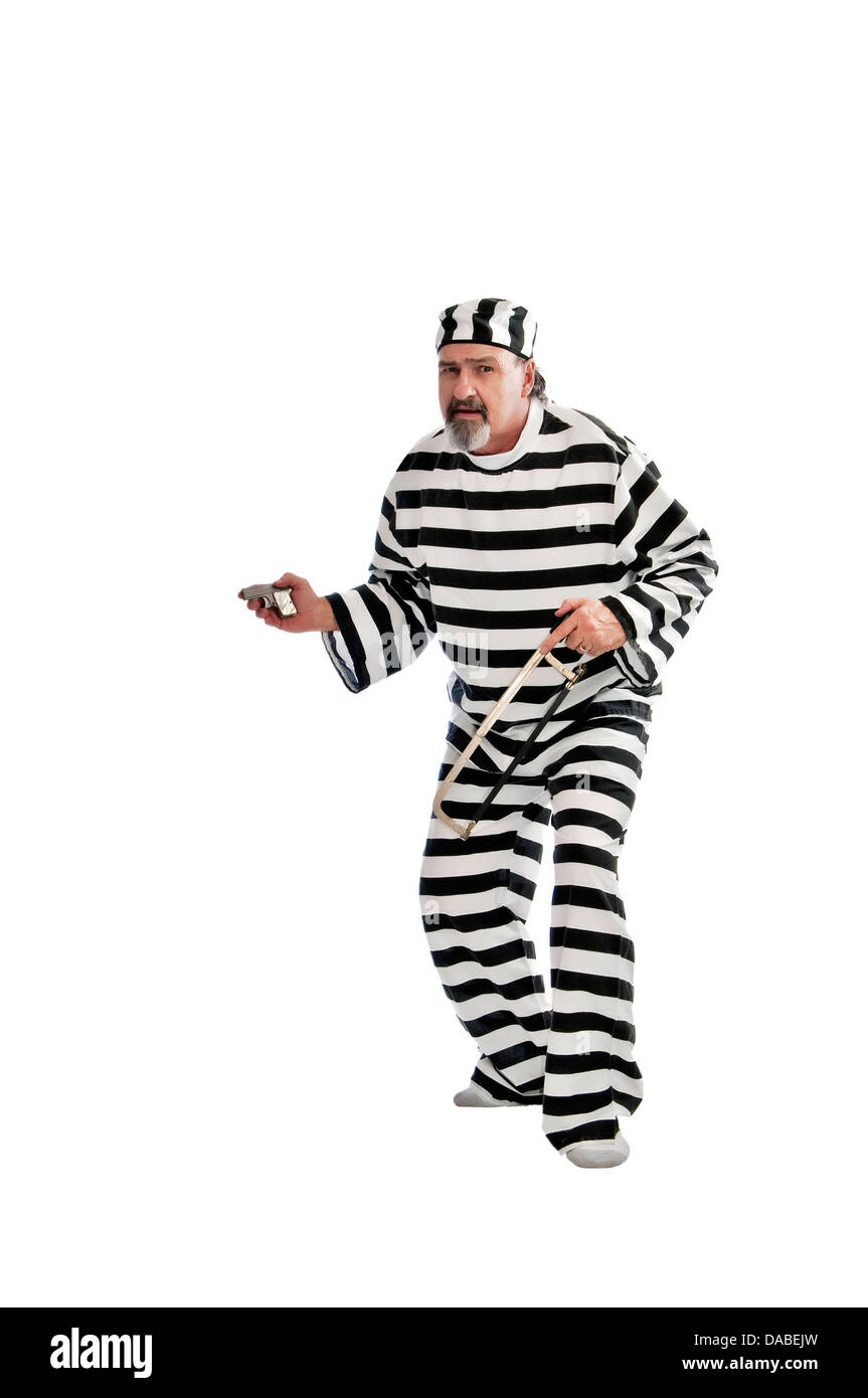 Shifty looking escaped convict with a gun. - Stock Image
