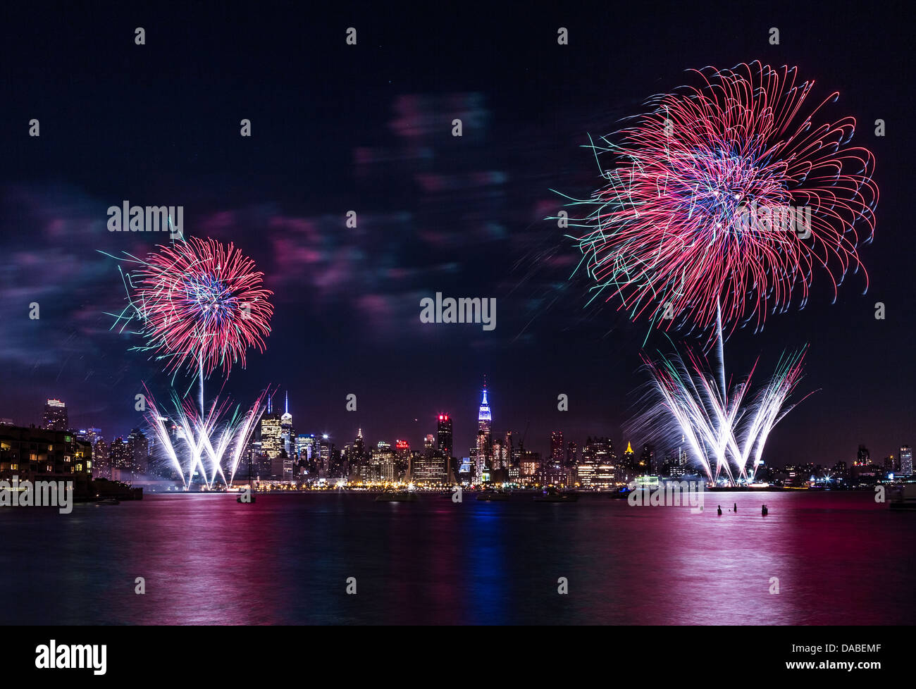 Macy's 4th of July fireworks on the Hudson river with the Manhattan skyline and the Empire State Building in the Stock Photo