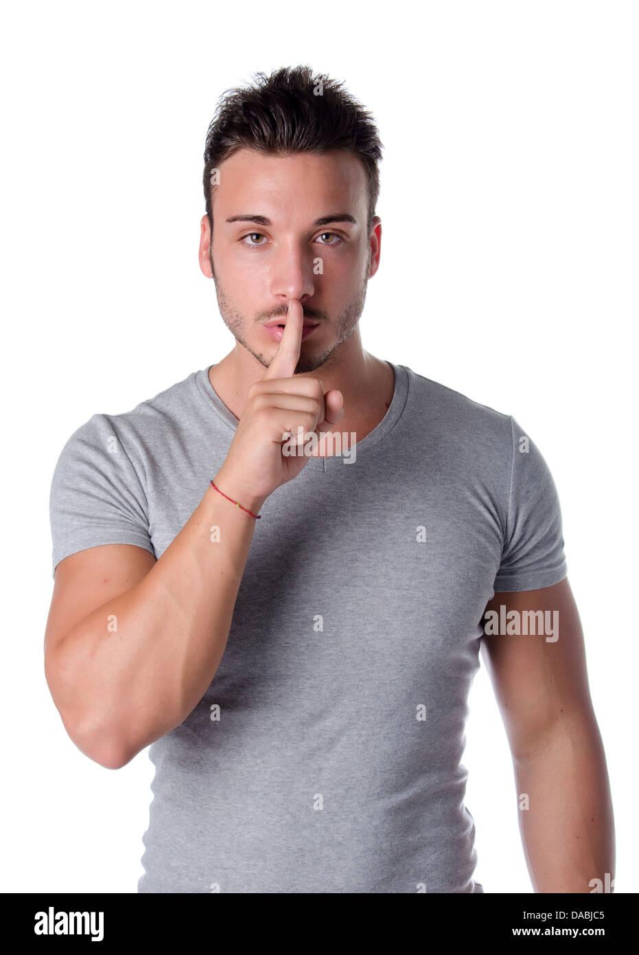 Hush. Young man silencing you, saying shut - Stock Image