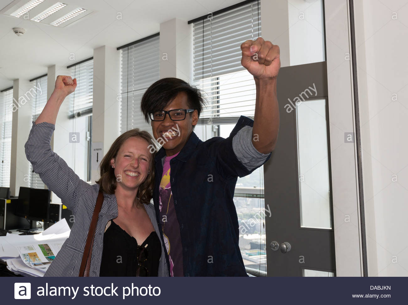 Two students one male one female  celebrating and smiling after getting their exam results Sheffield South Yorkshire - Stock Image