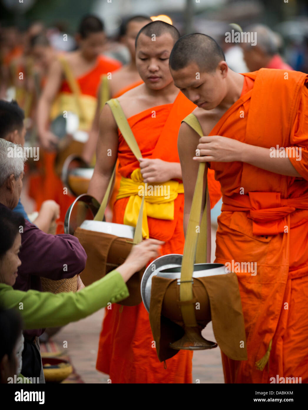 Buddhist Monks during Alms giving ceremony (Tak Bat), Luang Prabang, Laos, Indochina, Southeast Asia, Asia Stock Photo