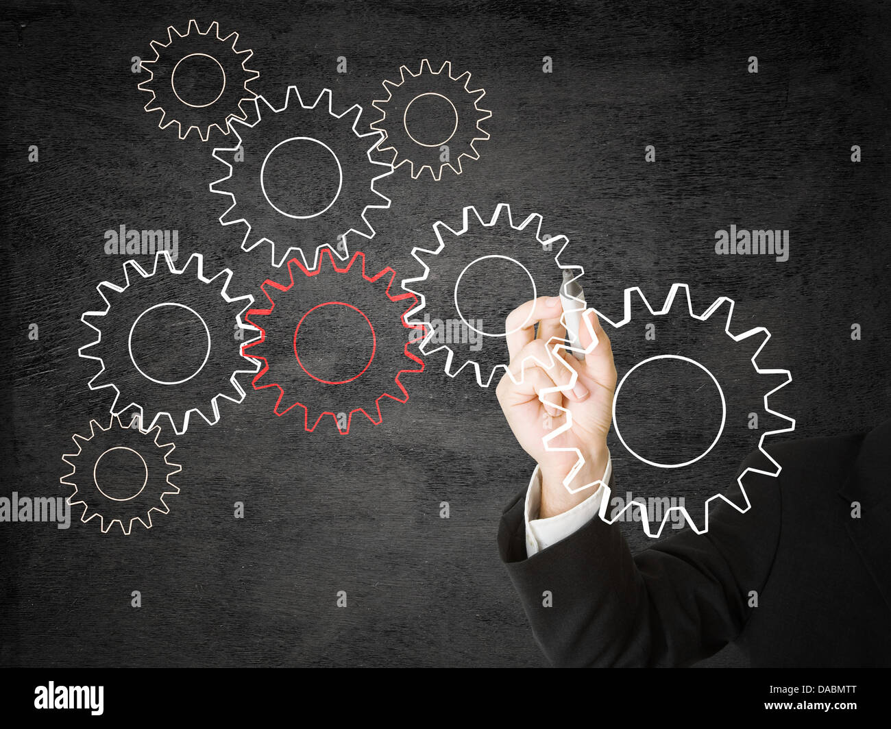 Businessman drawing cogwheels - networking or cooperation concept - Stock Image