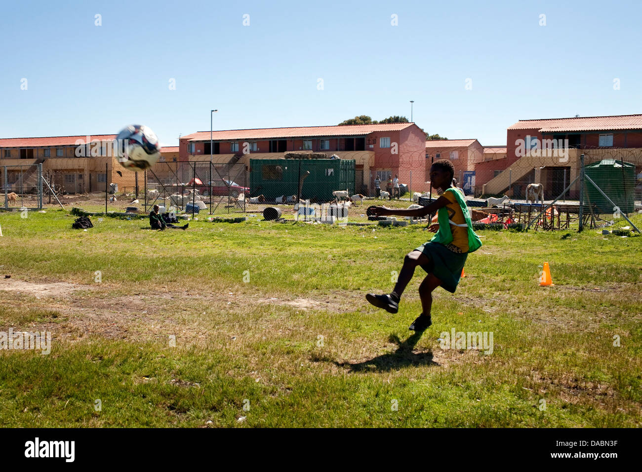 Grassroot Soccer uses power soccer to educate inspire mobilize communities to stop spread HIV goalie kicks ball - Stock Image
