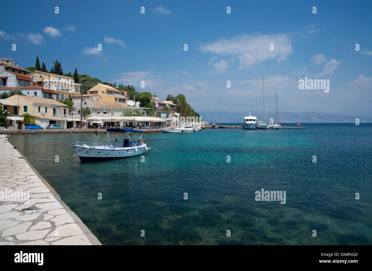 Boats in the harbour in Kassiopi on the northeast coast of Corfu, The Ionian Islands, Greek Islands, Greece, Europe Stock Photo