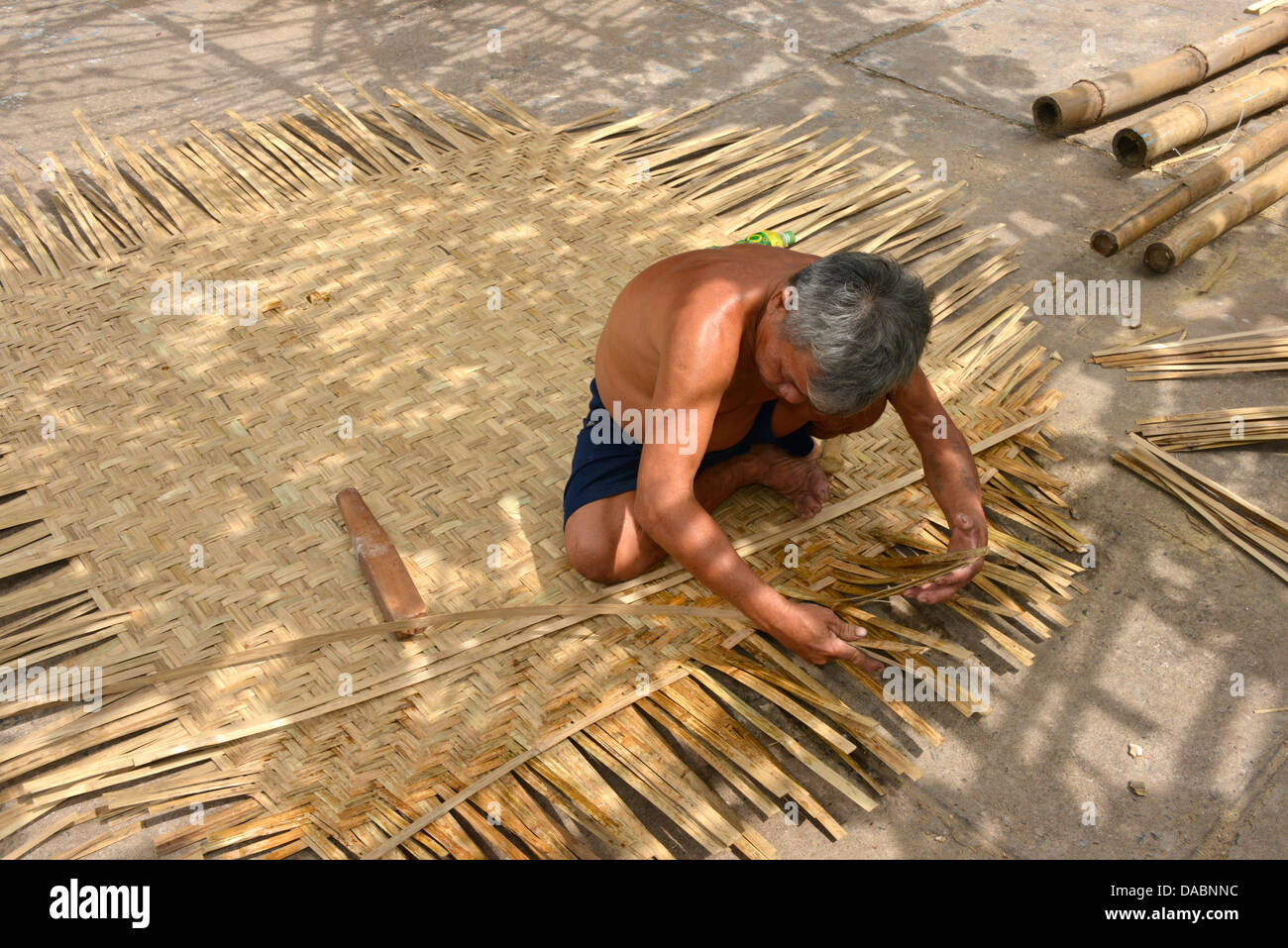 Weaving a basket tug boat, Phan Thiet, Vietnam, Indochina, Southeast Asia, Asia - Stock Image