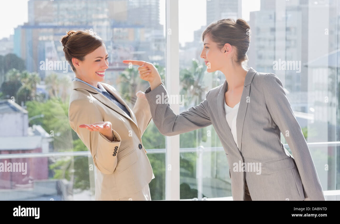 Businesswoman pointing at her rival - Stock Image