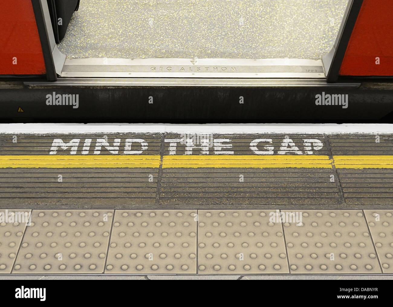 Mind the Gap Warning Sign on the Platform Edge of a London Underground Station. - Stock Image