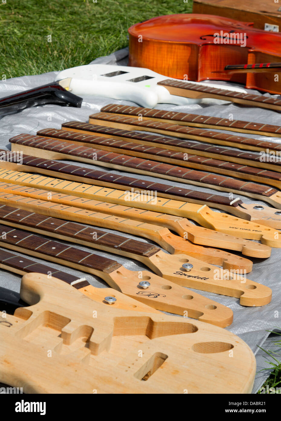 Guitar necks at a flea market - Stock Image