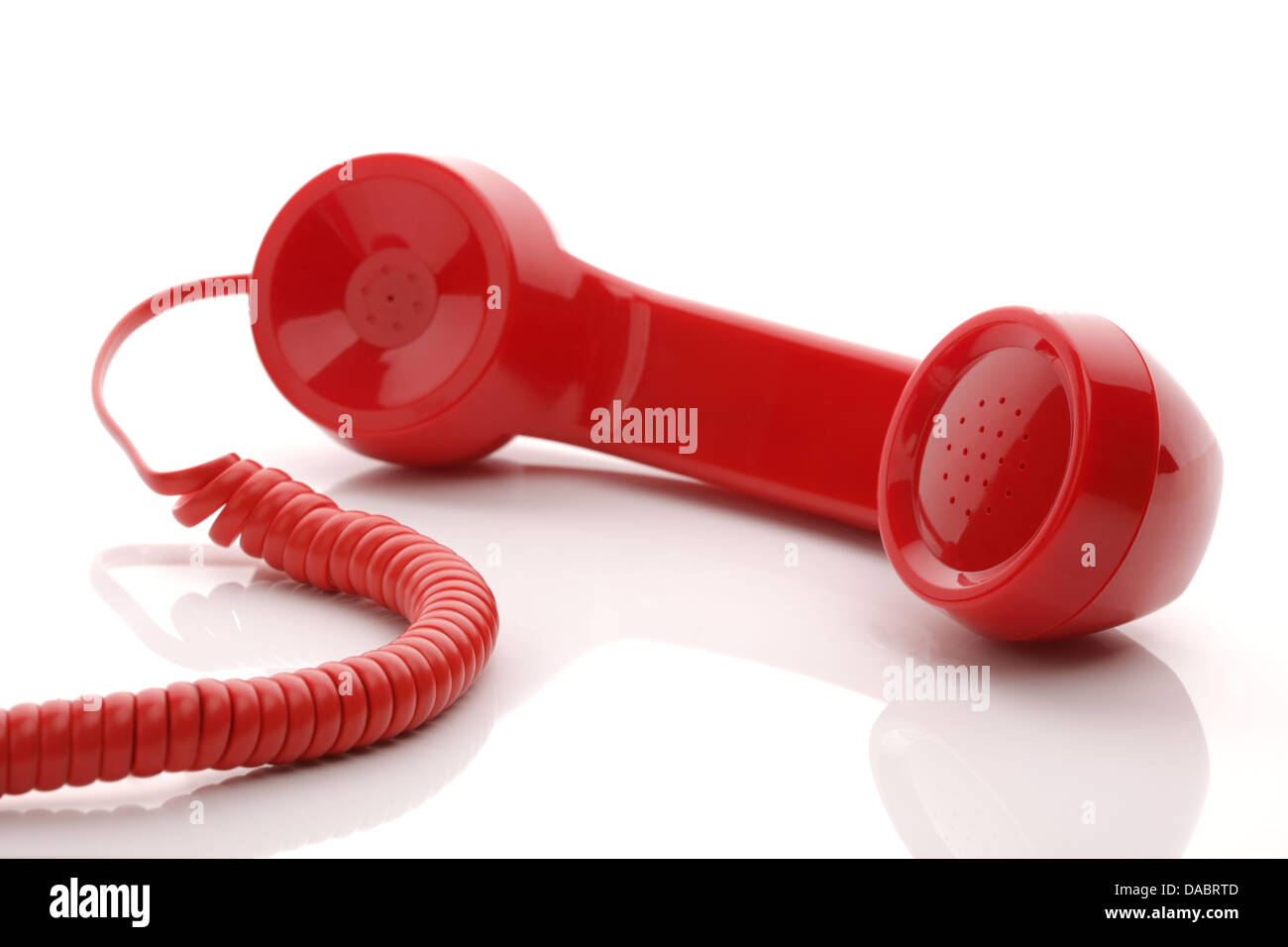 Red telephone receiver - Stock Image