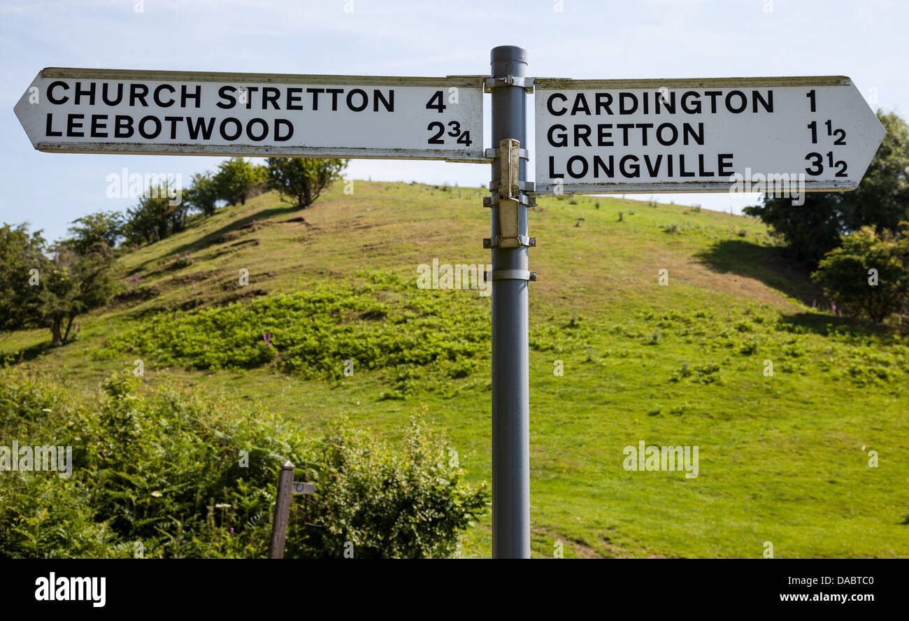 Signposts at a road junction near Enchmarsh, Church Stretton, Shropshire - Stock Image