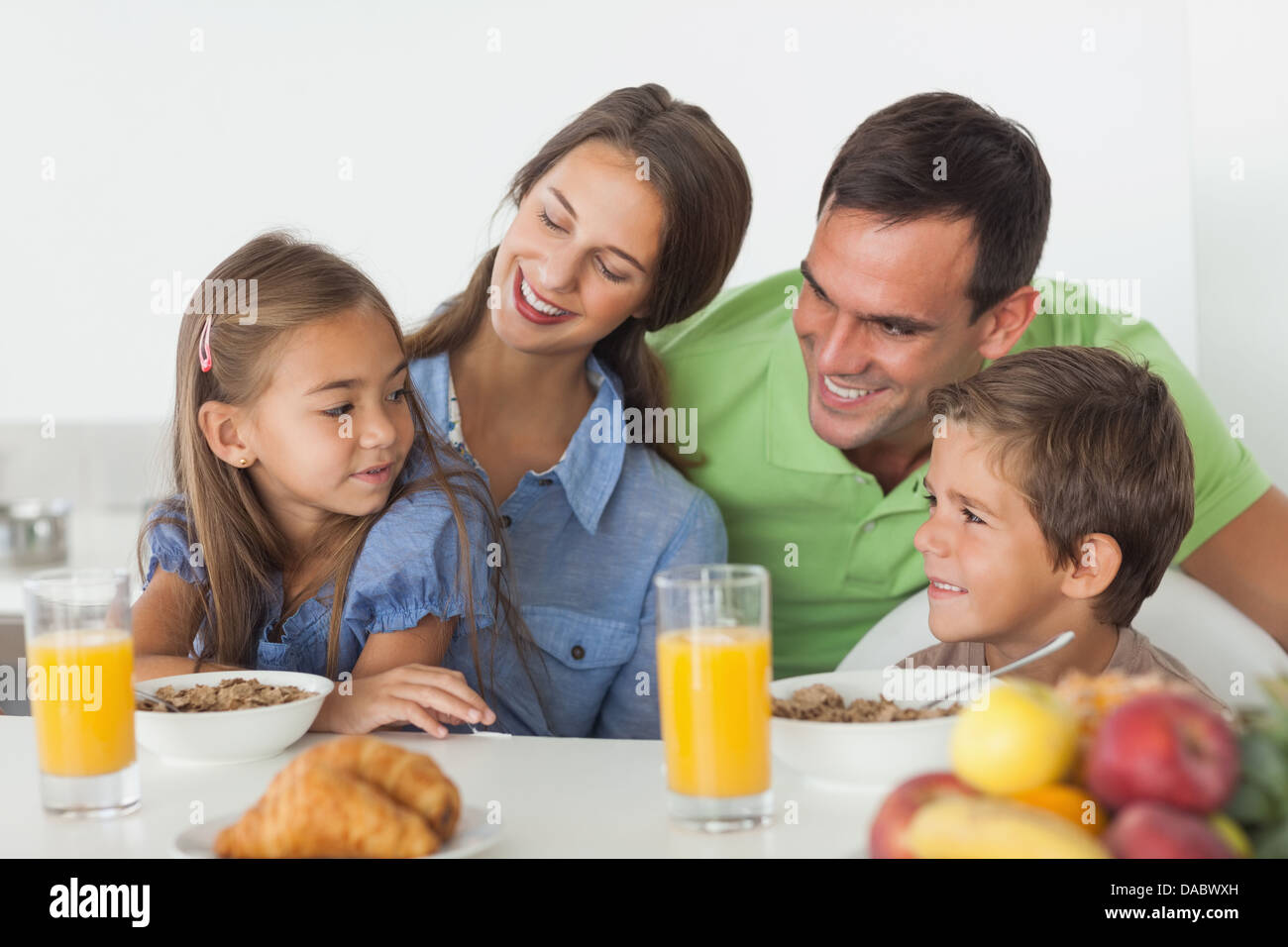 Parents having breakfast with their children - Stock Image