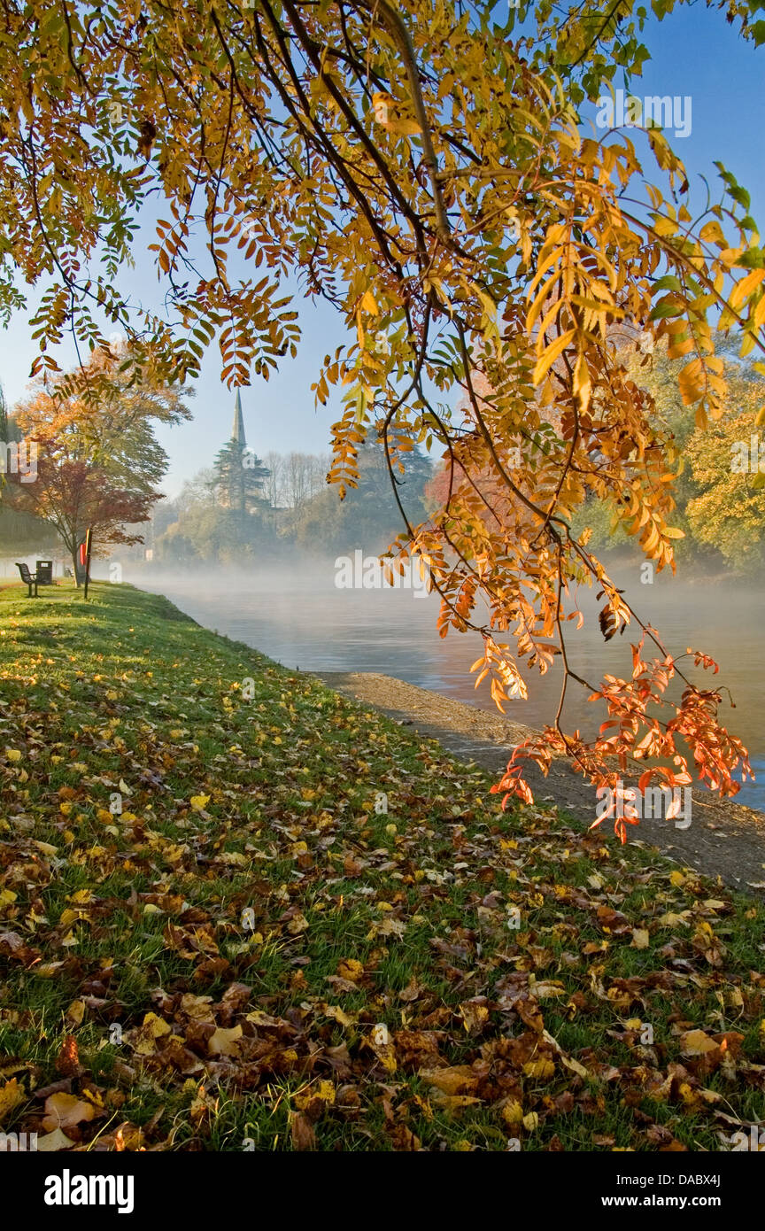 Stratford upon Avon, Warwickshire and the spire of Holy Trinity church on a misty autumnal morning on the River - Stock Image