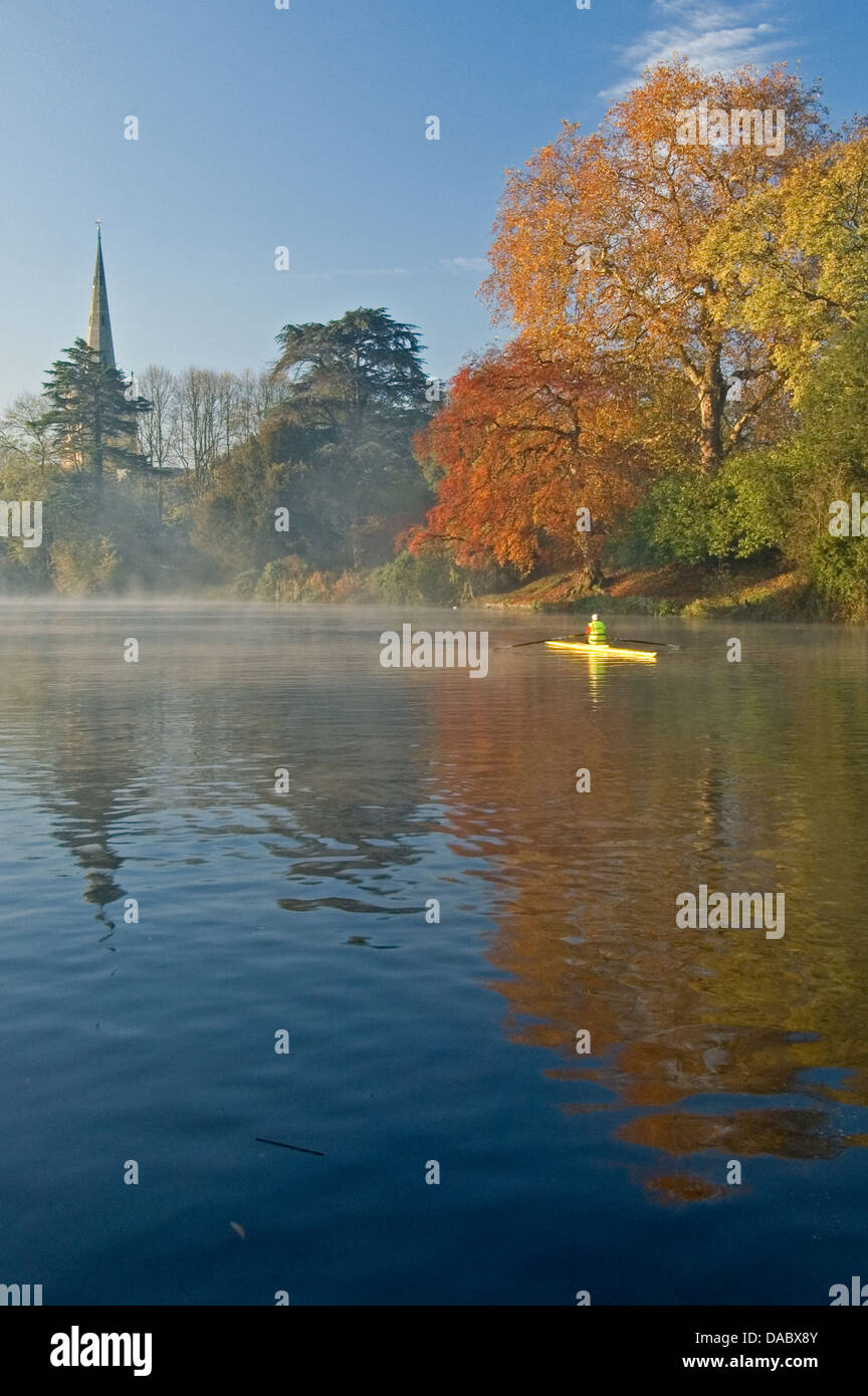 Stratford upon Avon and the spire of Holy Trinity church on an autumnal morning on the River Avon, Warwickshire - Stock Image