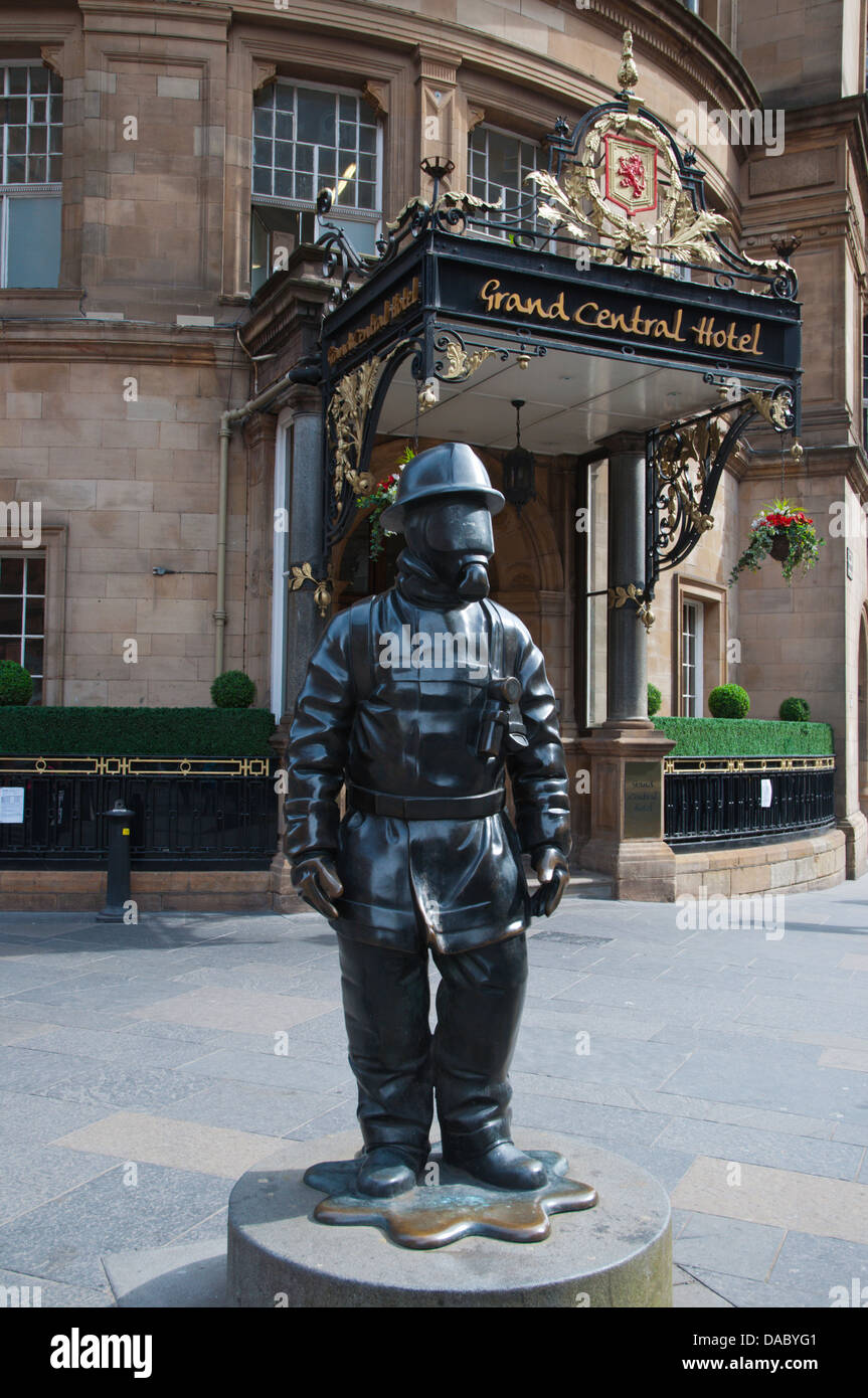 The Citizen Firefighter statue (2001) in front of central station Glasgow Scotland Britain UK Europe - Stock Image