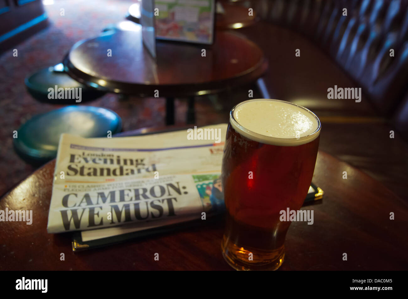 the Evening Standard newspaper and a pint of beer Fitzroy tavern pub London England Britain UK Europe - Stock Image
