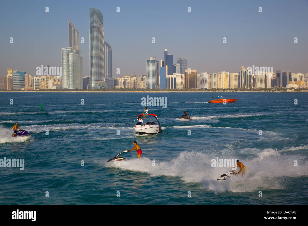 View of city from Marina and Jet ski Water sport, Abu Dhabi, United Arab Emirates, Middle East - Stock Image