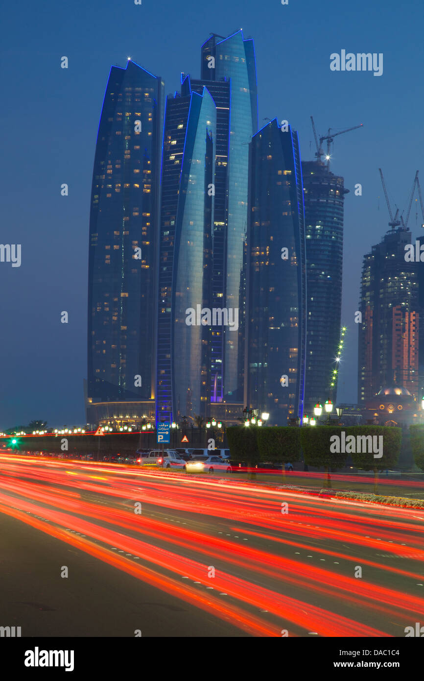 Emirate Towers and car tail lights at night, Abu Dhabi, United Arab Emirates, Middle East - Stock Image