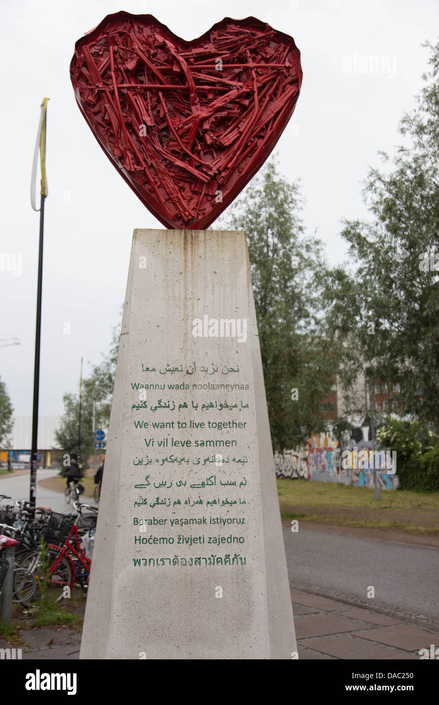 Copenhagen: monument stating in many languages 'We want to live together' in immigrant district Norrebro - Stock Image