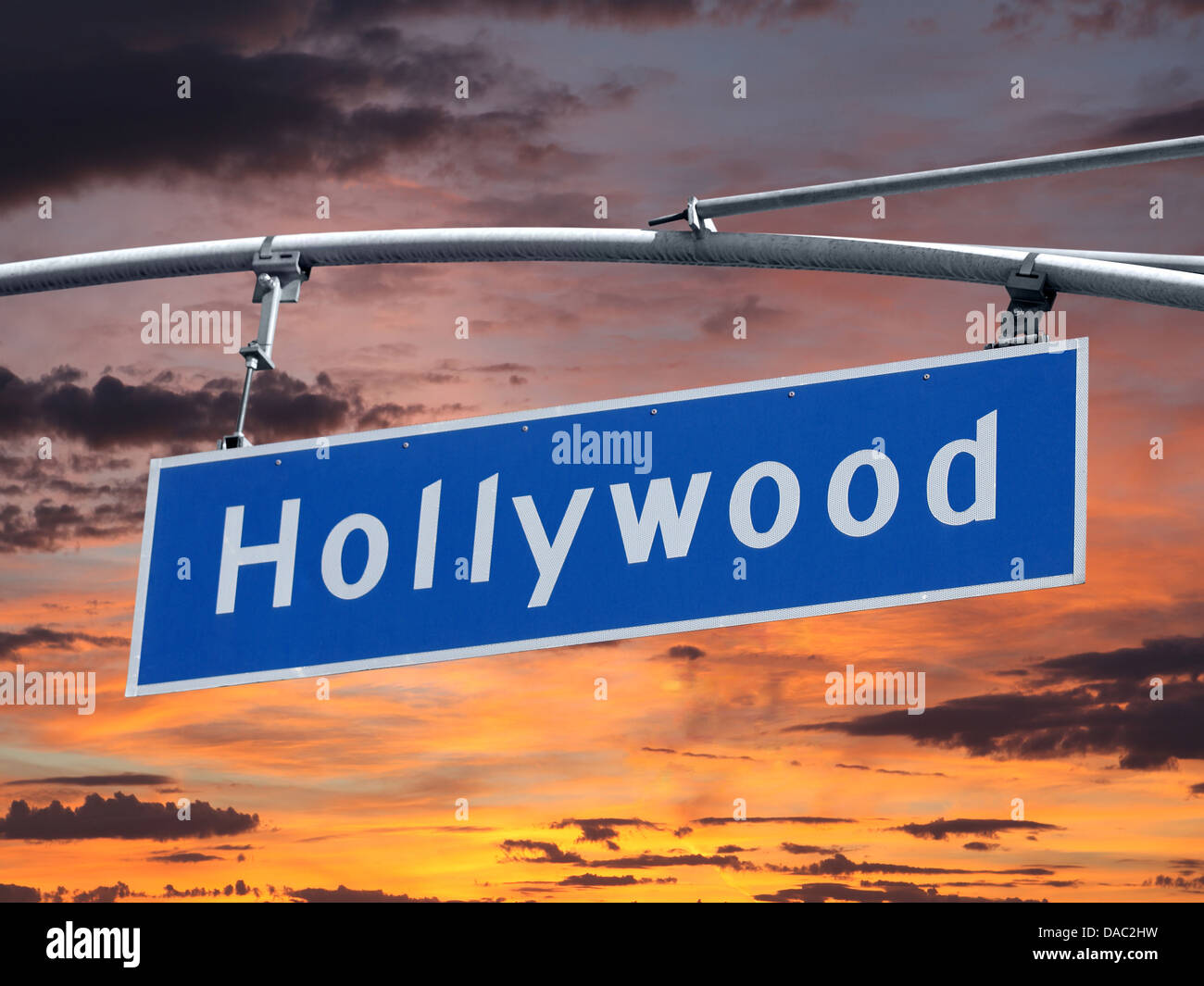 Hollywood Blvd street sign with orange sunset sky - Stock Image