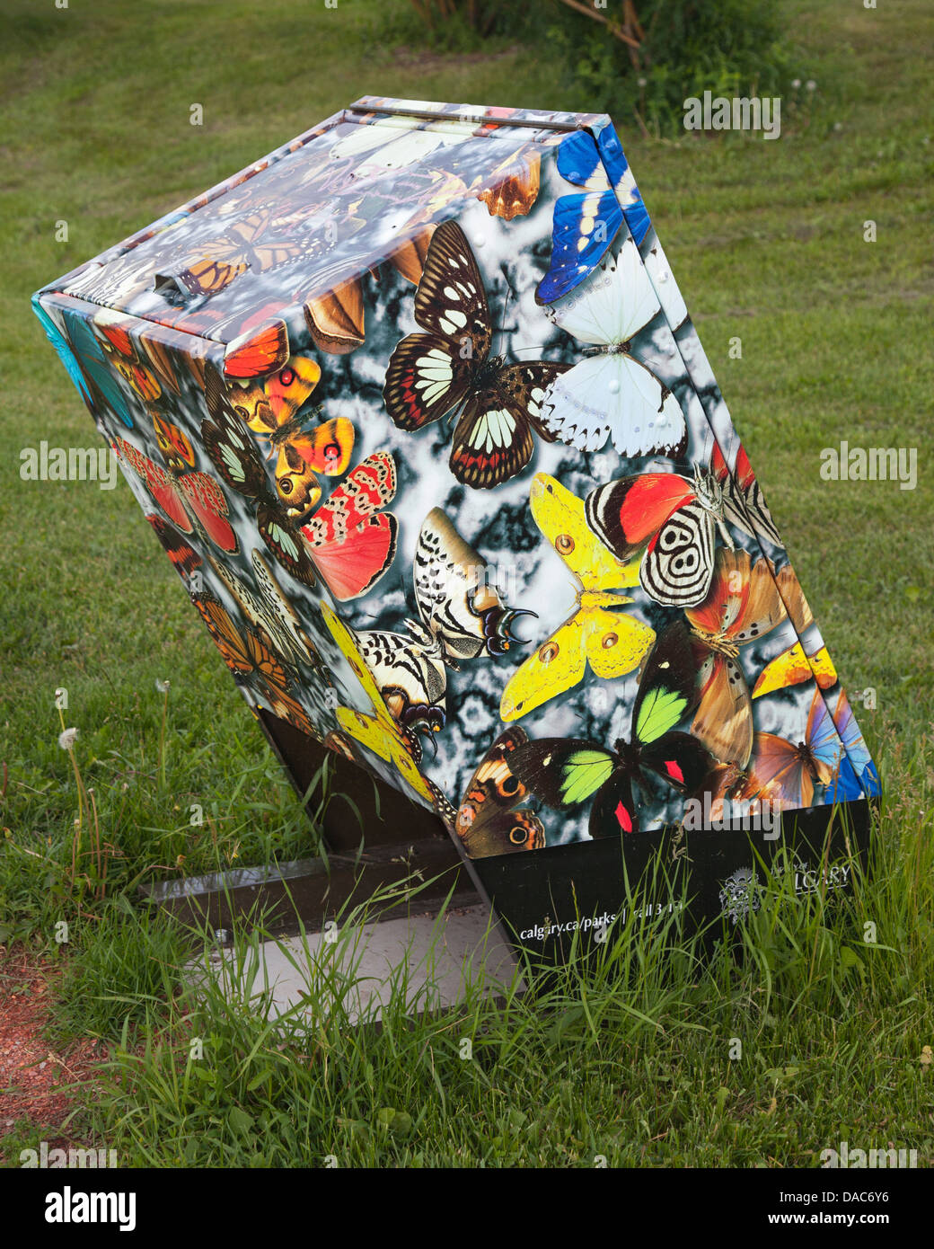 Garbage can decorated with butterflies - Stock Image