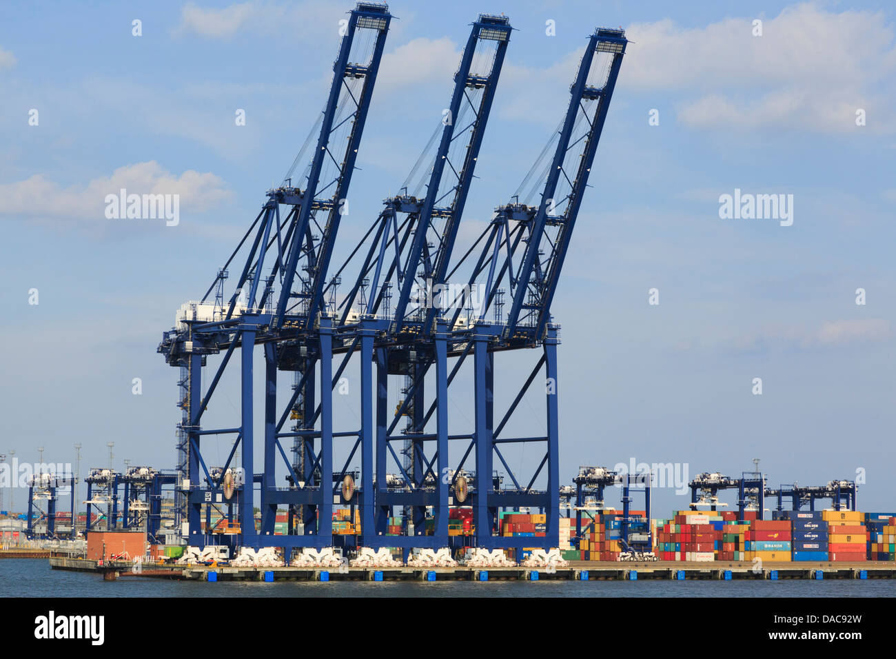 Gantry cranes for lifting containers on dockside terminal quay of largest British container port in UK. Felixstowe - Stock Image