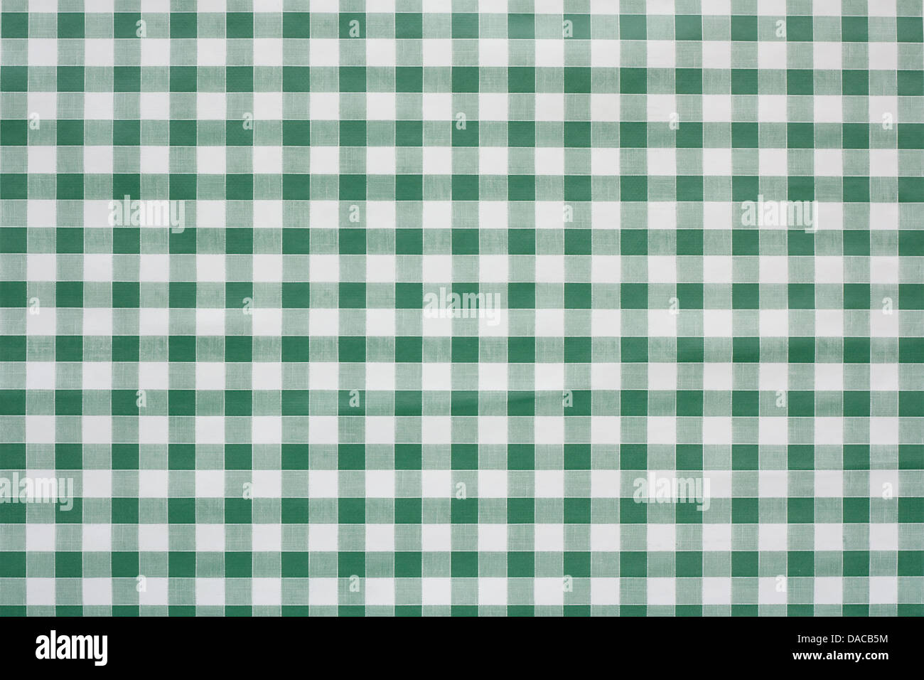 Green gingham tablecloth often found in diners and cafes a popular traditional covering for tables where food is - Stock Image