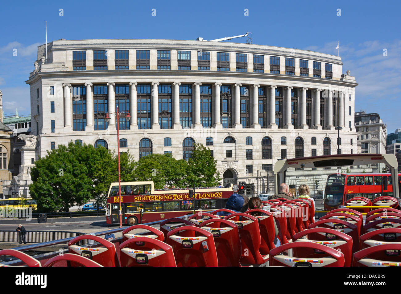 London open top sightseeing tour buses at Unilever House Blackfriars City of London England UK Stock Photo