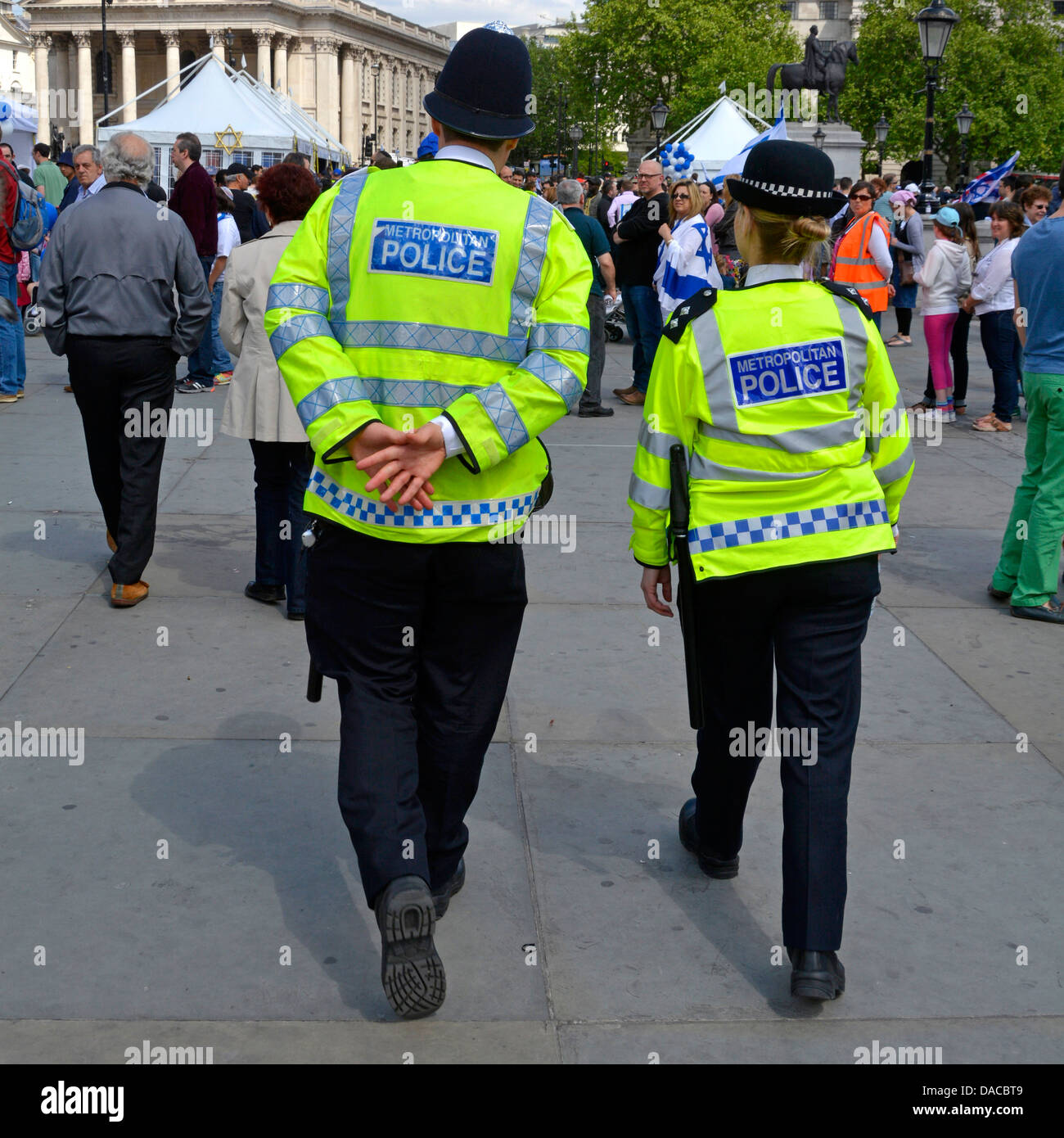 Uniformed male and female police officer on foot patrol - Stock Image