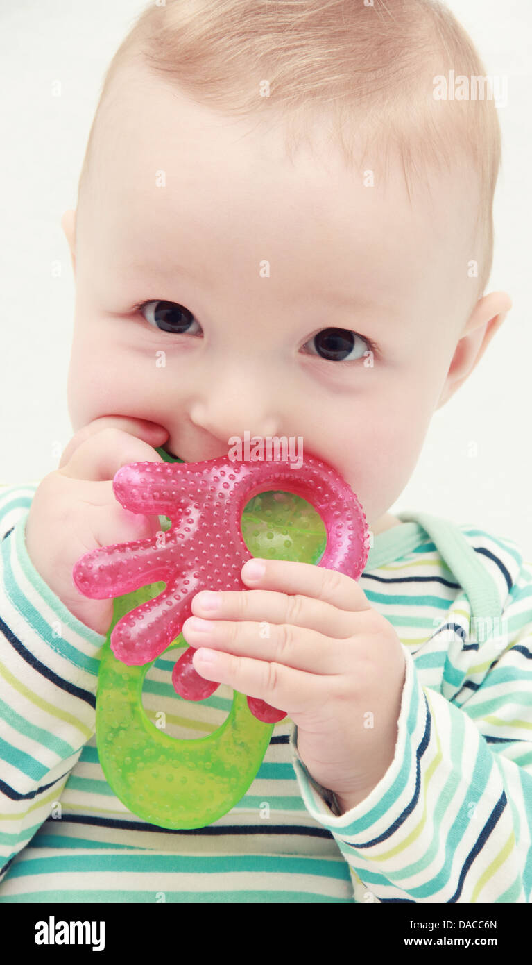 beautiful baby with teether Stock Photo
