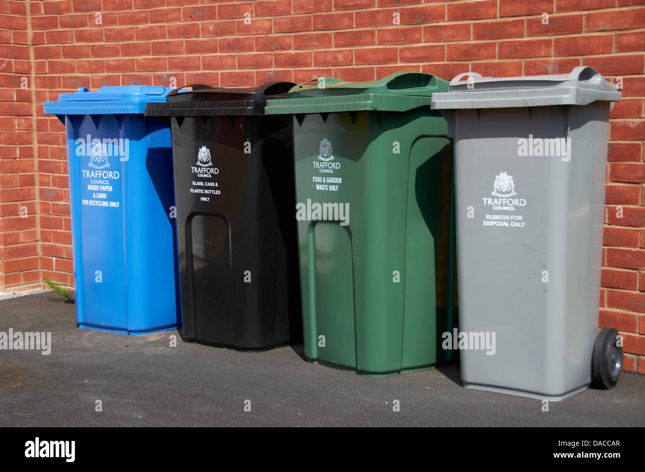 Bins outside a house ready for collection. - Stock Image