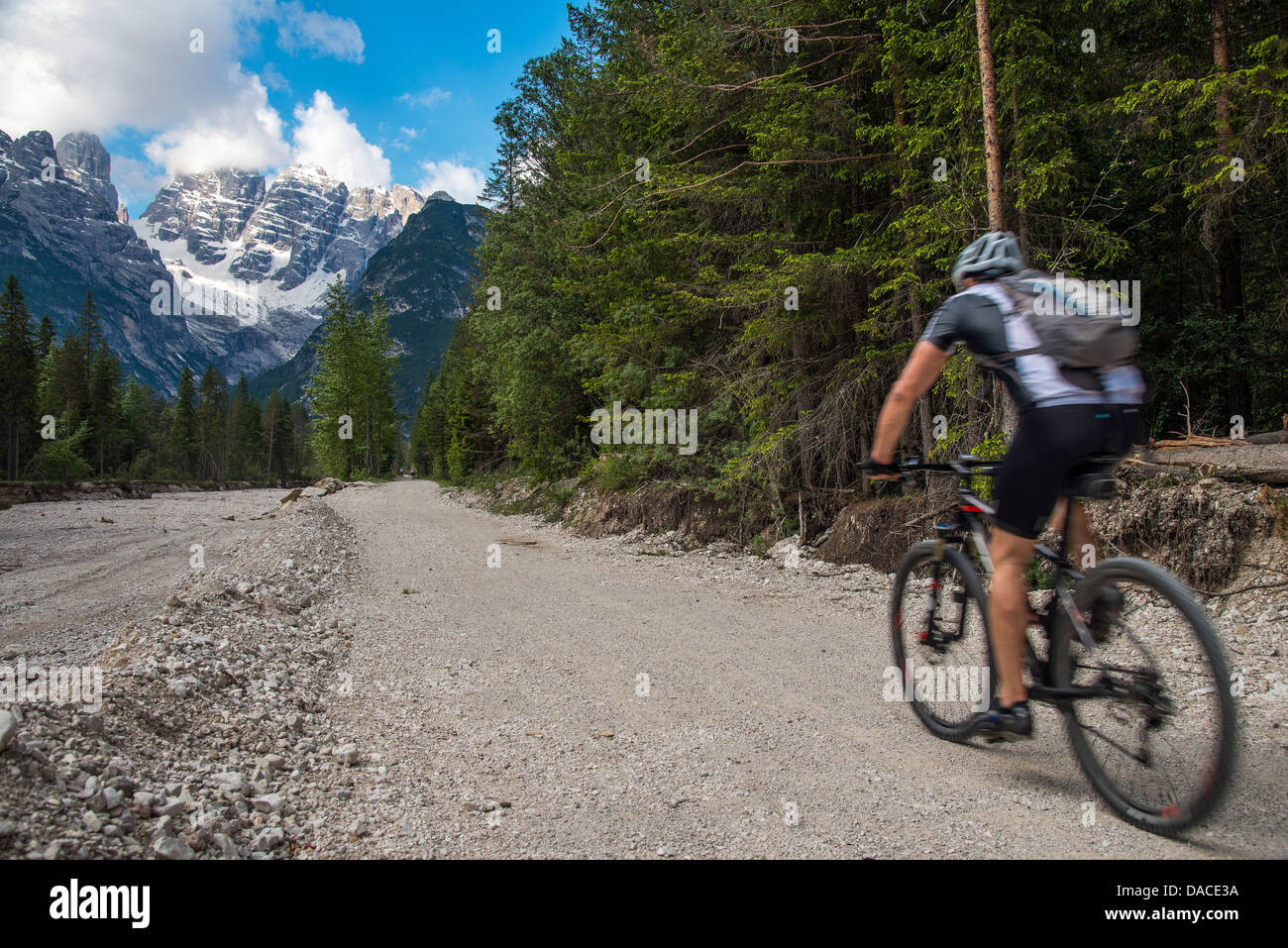 Mountain biker riding in the Dolomites, Alto Adige or South Tyrol, Italy - Stock Image