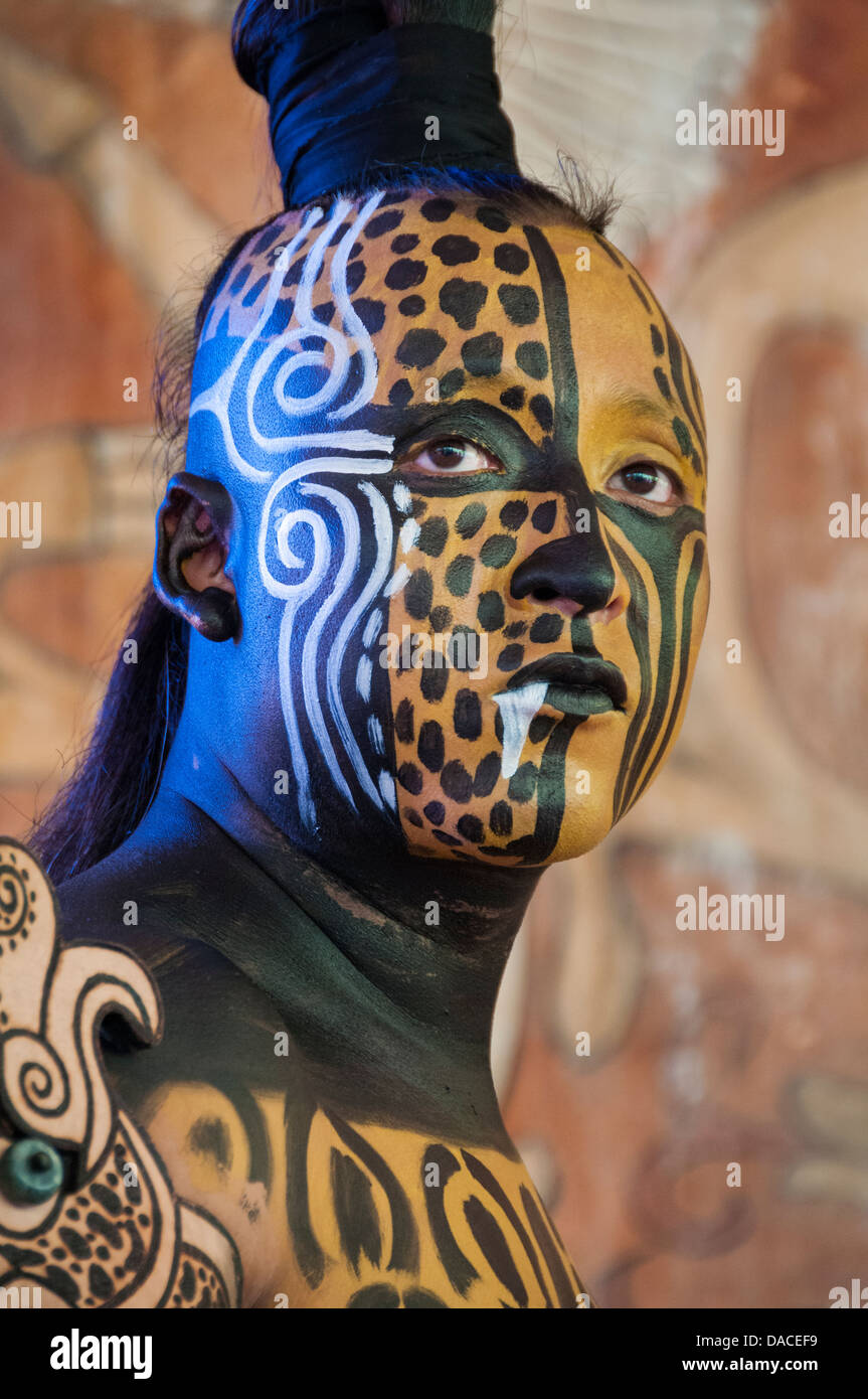 Man portraying the pre-Hispanic Maya warrior diety of the sacred Jaguar at Xcaret eco-archeological park, Riviera - Stock Image