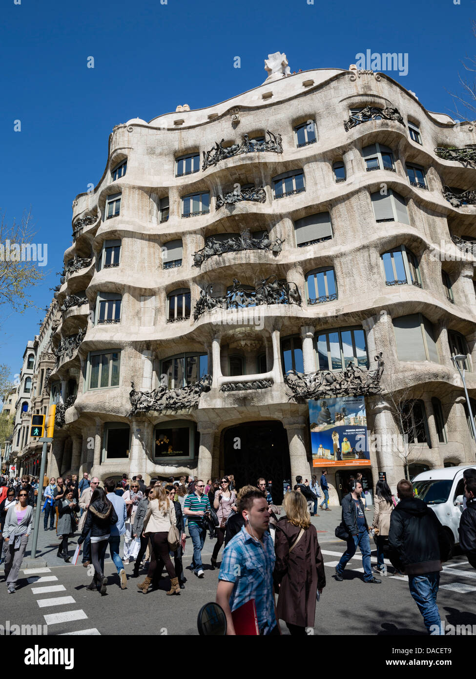 Busy street in front of La Pedrera - Stock Image