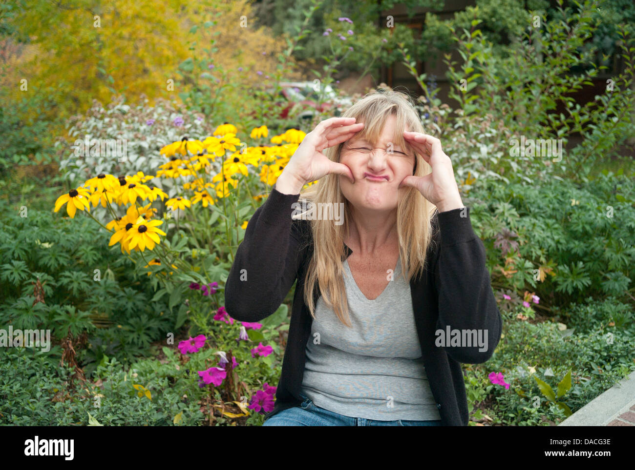 Woman making a goofy face. - Stock Image
