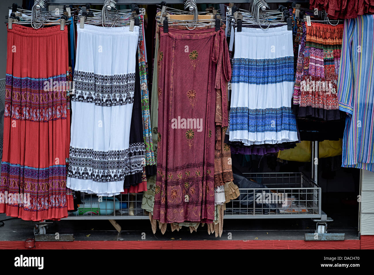 Shop display of brightly colored woman's skirts and casual dress. Thailand S. E. Asia - Stock Image