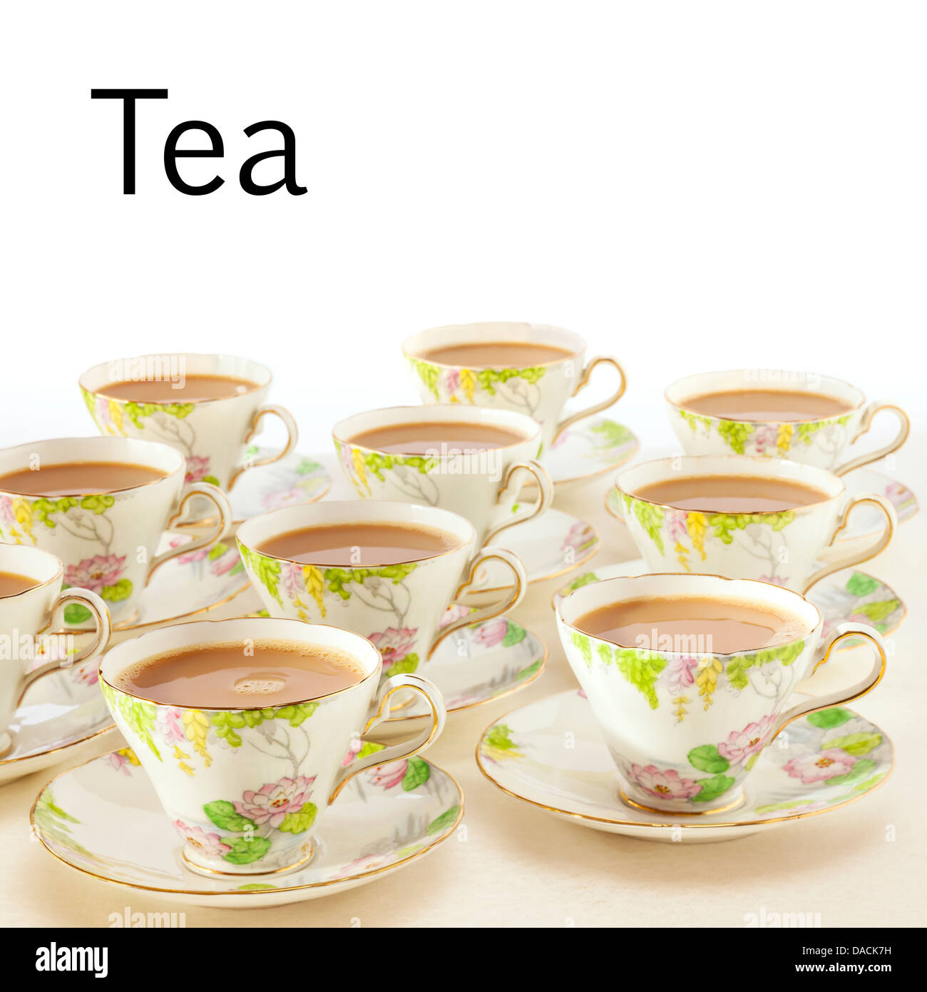 Tea Concept - cups of freshly poured tea in beautiful antique crockery. This image can be fully customised with - Stock Image