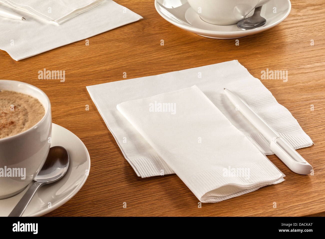 Serviette and Pen - napkin or serviette and pen on table, ready to make a note of your latest great idea, along - Stock Image