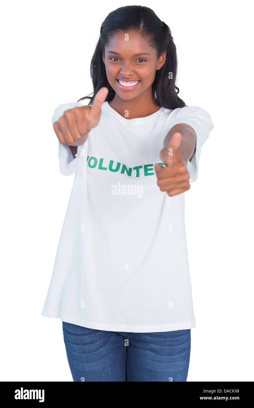 Young woman wearing volunteer tshirt and giving thumbs up - Stock Image