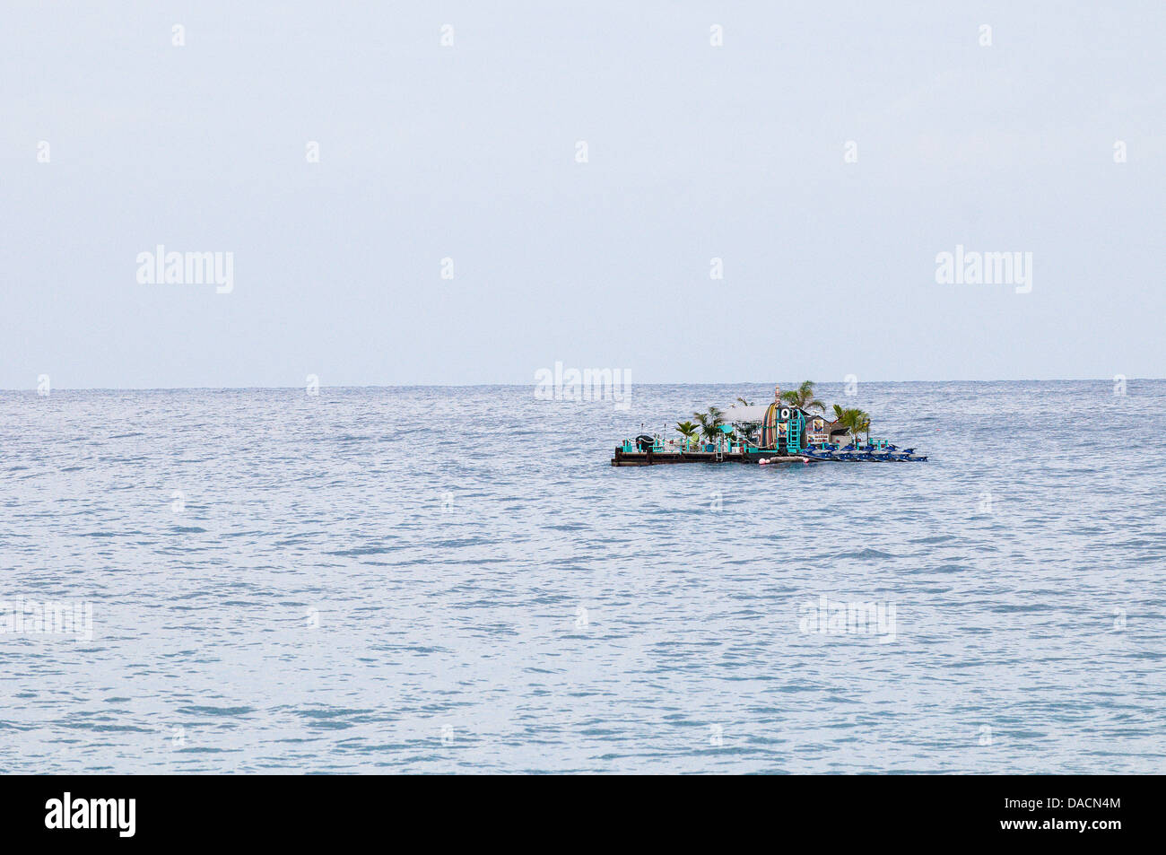 Tourist watersports rafted anchored off the Kailua-Kona shoreline, Big Island, Hawaii - Stock Image
