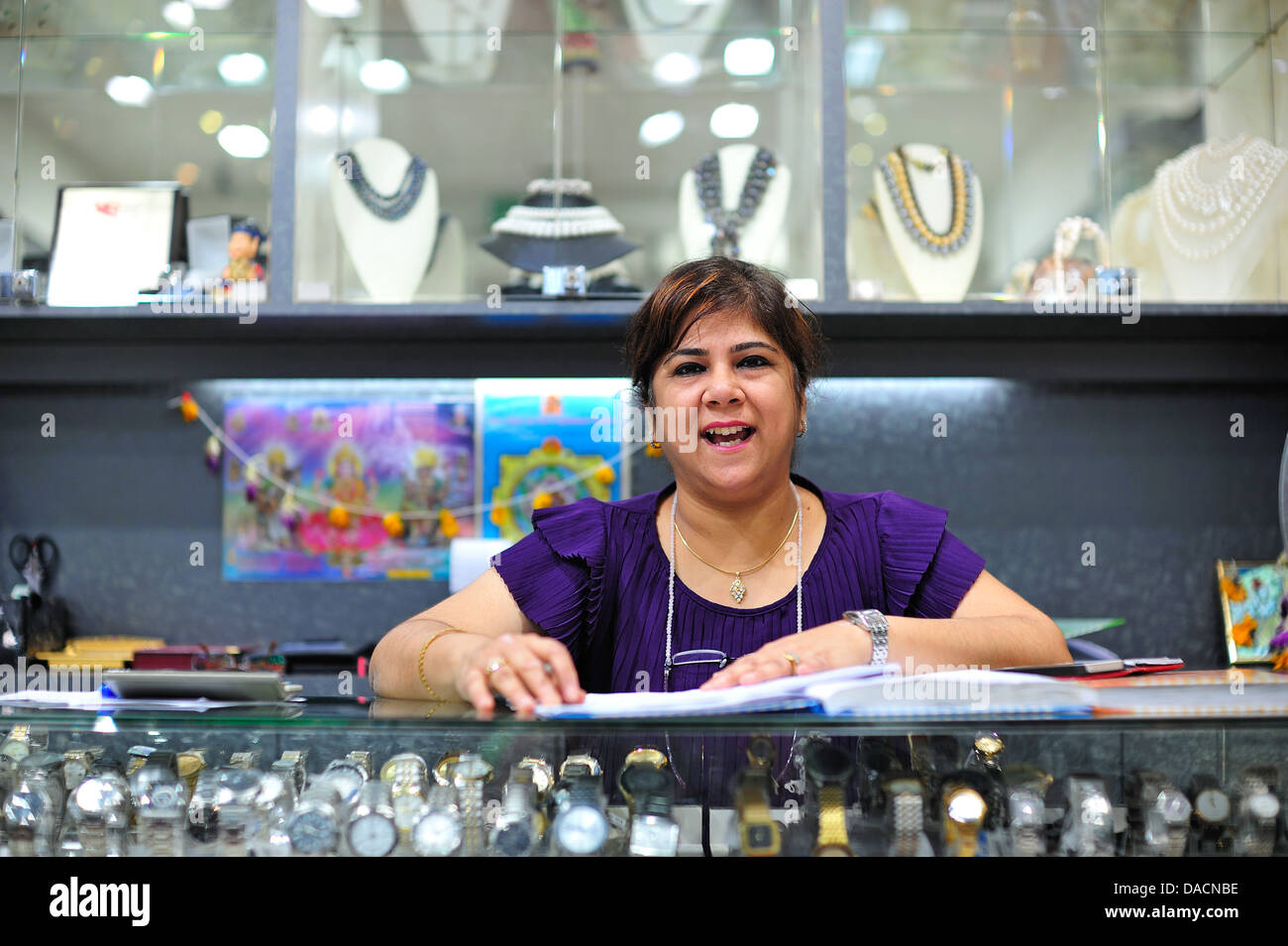 Lady Working in Myer's Jewellery Chinatown Singapore - Stock Image