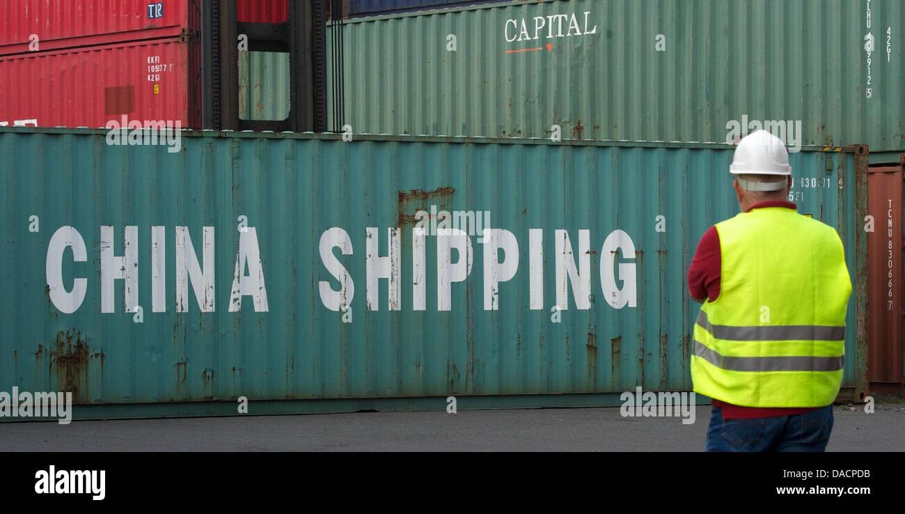 A man stands in front of a container with the words 'China