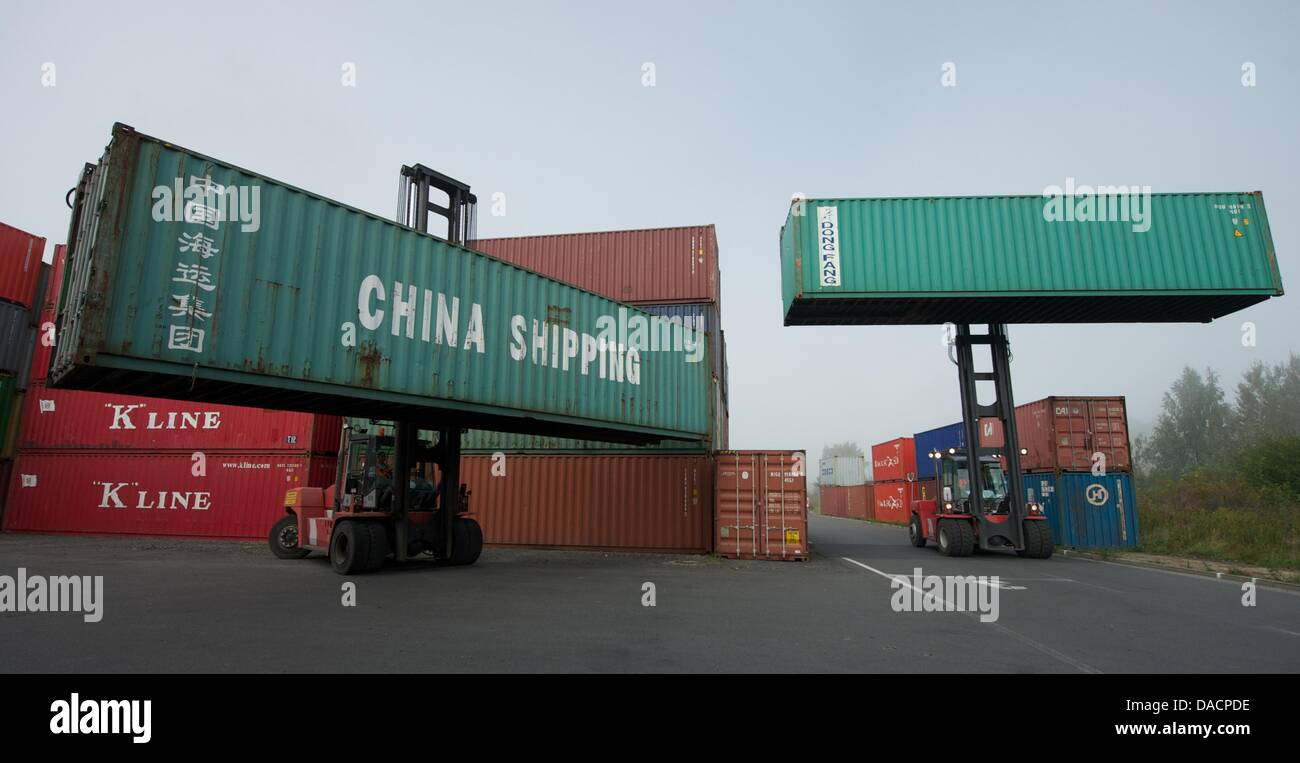 A fork truck lifts a container with the words 'China Shipping' at